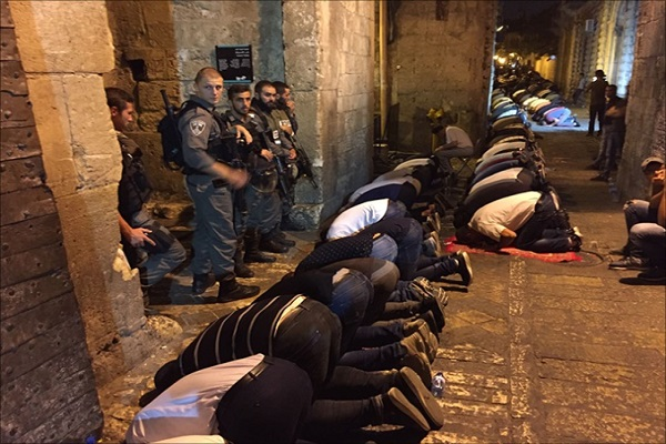 Palestinians Hold Friday Prayers Outside Al-Aqsa Gates