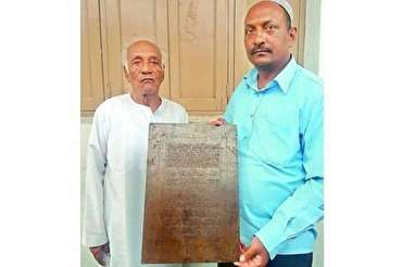 Family in Hyderabad, India, Engraving Quran Verses on Iron Plaques
