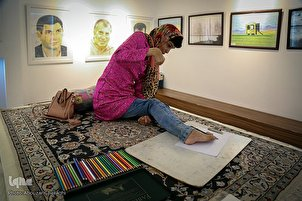 Exhibition Showcases Artworks by Paralyzed Iranian Artist