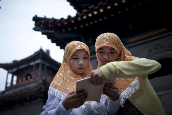 منع حضور کودکان مسلمان چینی از شرکت در مراسمهای دینی /انگلیسی